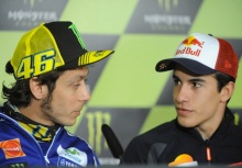 Yamaha Factory MotoGP's Italian rider  Valentino Rossi  (L) looks to Repsol Honda Team's Spanish rider Marc Marquez (R) during a press conference  after a free practice session at Le Mans' circuit, western France on May 16, 2014 two days ahead of the MotoGP French Grand Prix. AFP PHOTO JEAN-FRANCOIS MONIER        (Photo credit should read JEAN-FRANCOIS MONIER/AFP/Getty Images)